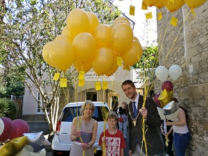 Alison Fielden, Mark Harris and his son prepare to release 30 balloons to celebrate Alison Fielden & Co.'s 30th anniversary